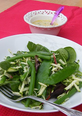 green bean salad in a white bowl with creamy salad dressing