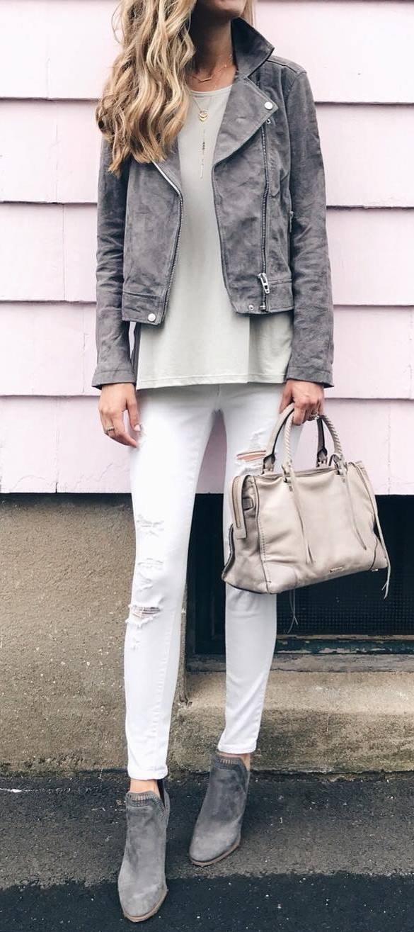 how to wear a grey moto jacket : white top + rips + boots + bag