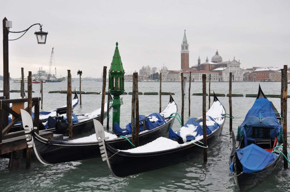 Snow-covered gondolas with San Giorgio Maggiore as a backdrop, Venice, Italy