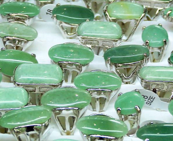 green jade rings in white gold setting