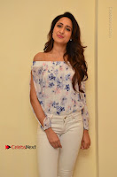 Actress Pragya Jaiswal Latest Pos in White Denim Jeans at Nakshatram Movie Teaser Launch  0039.JPG