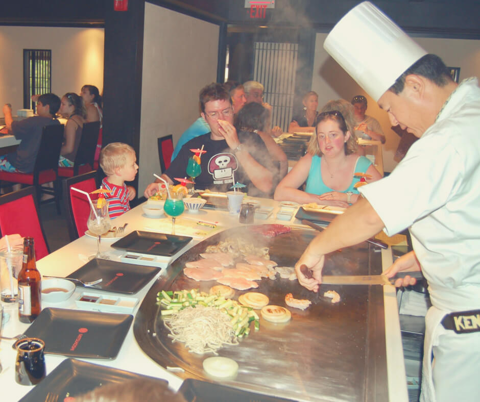 Inside Tepan Edo, one of the best places to eat in Walt Disney World theme parks. A chef cooks food at the table.