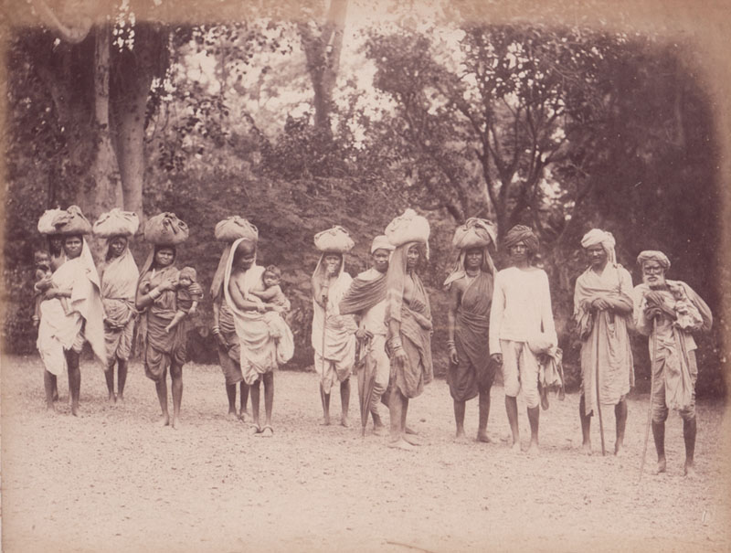Natives of Central India carrying small packs on their head