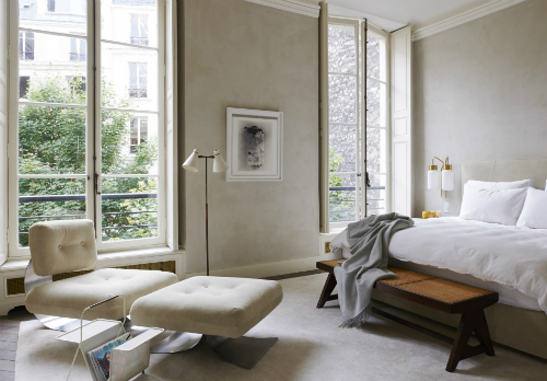 Bedroom with grey walls, wooden floor and big windows