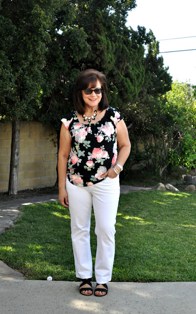 white jeans and black floral blouse