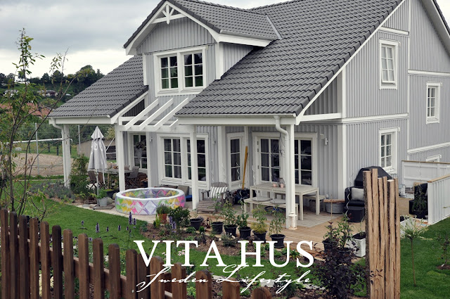 Schwedenhaus Split - Level, grau, Holzfassade,