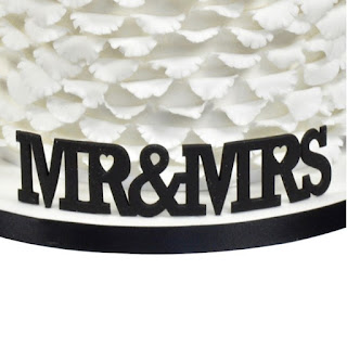 http://www.cake-links.com/fmm-plastic-cutters/mr-and-mrs-curved-words.html