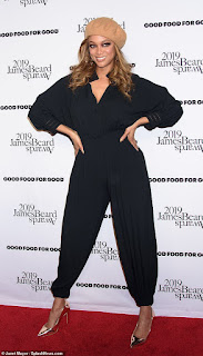 Tyra Banks embraces her style icon status in a plunging black jumpsuit
