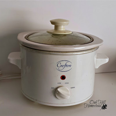 "I use this small crockpot with a ""warm"" setting to infuse herbs in oil."