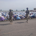 Soldiers protect Muslims as they offer prayers at an Eid praying ground in the North