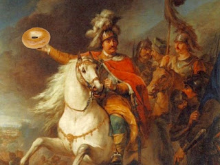 a classical looking painting of soldiers on horseback, with one holding a bagel