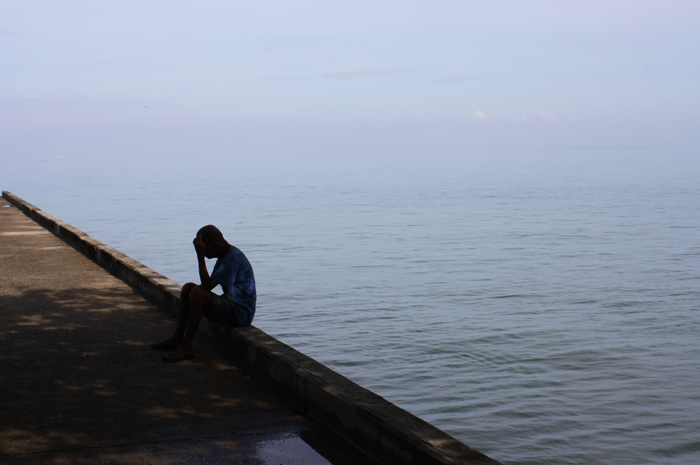 A local of Matalom contemplating in the port