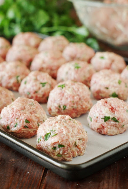 Baked Homemade Meatballs ~ full of flavor and the tender meatball texture we crave!  www.thekitchenismyplayground.com
