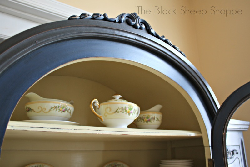 The barrel top provides just enough room for an additional shelf at the top for storing smaller pieces.