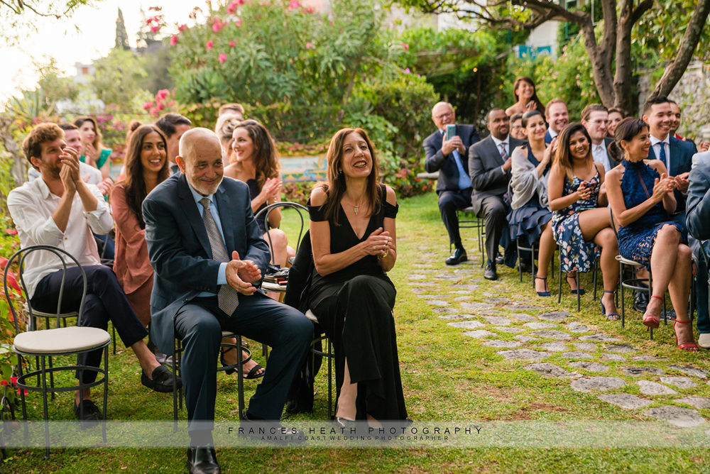 Guests clapping at the end of the wedding ceremony