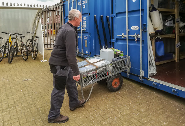 Photo of Phil delivering some of our stuff to the marina storage container