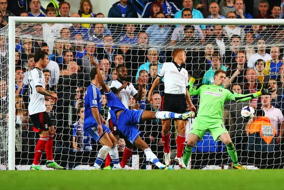Chelsea player John Obi Mikel scores his side's second goal against Fulham