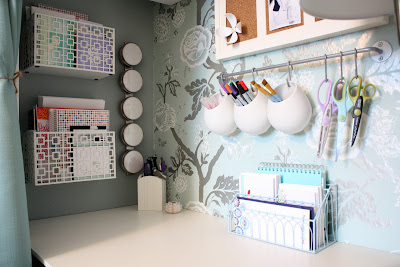 Home office organizing tips. Attach baskets to walls for folders, reference guides or craft papers. Attach a towel bar or rail above your desk space with hooks for hanging scissors, tape, and Asker Cups from Ikea that can hold pens, pencils and more.