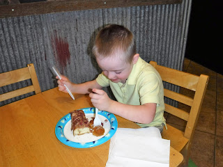 boy eating donut at child sized table and chairs at FlyBoy Donuts in Sioux Falls, South Dakota