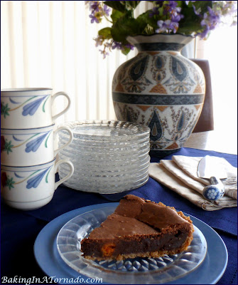 Brownie Butterfingers Pie, a dressed up option to brownie squares. Walnut crust, brownie filling with bits of butterfingers, this pie is perfect for company | Recipe developed by www.BakingInATornado.com | #recipe #chocolate #dessert