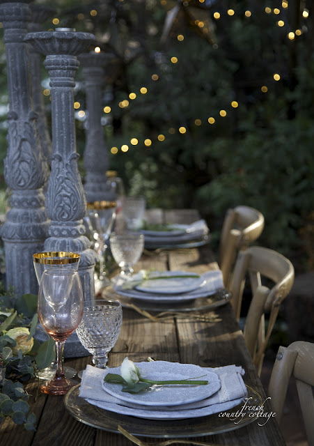 Table setting outdoors with wine glasses and plates