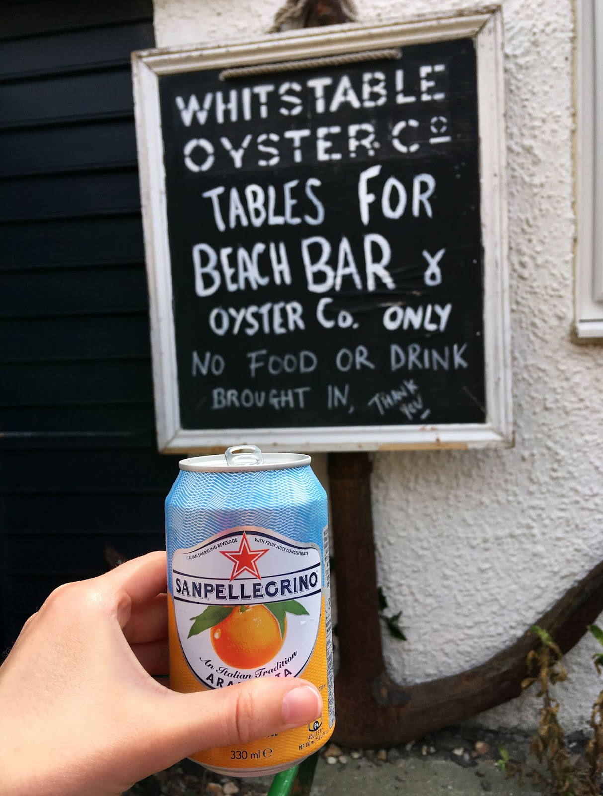 Having a San Pellegrino fizzy orange drink at the Whitstable Oyster Co. bar in Whitstable