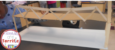STEM Bridge! Let's build a suspension bridge using craft sticks and glue! Can you add string to make it resemble a rel suspension bridge?