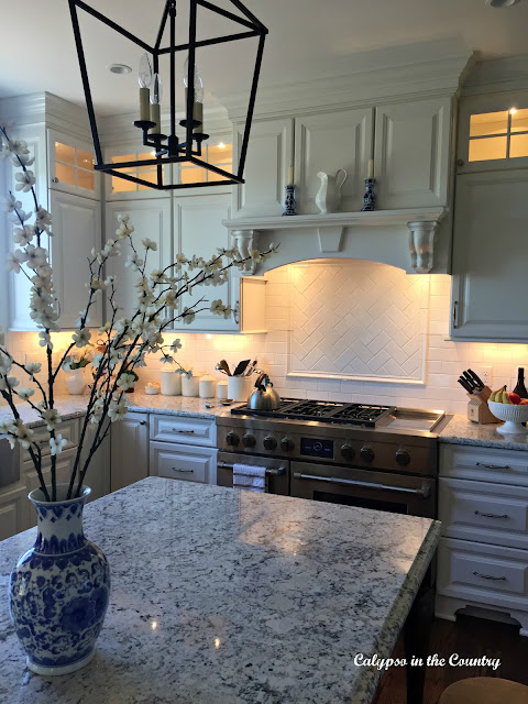 Kitchen island with blue vase