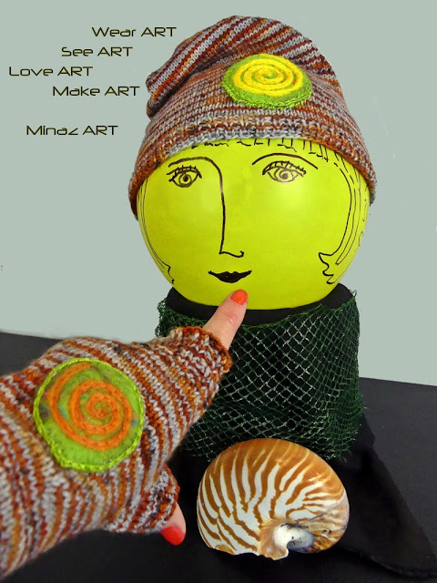 Spiral Orange Knit Slouchy Hat & Fingerless Gloves by Minaz Jantz