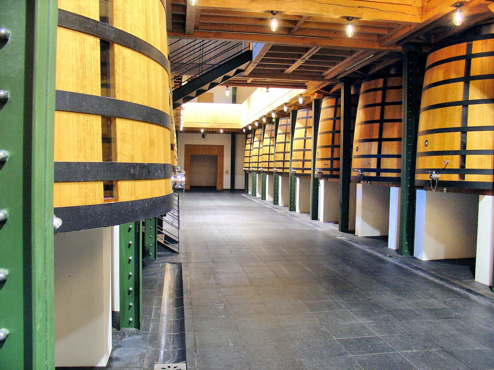 Huge oak barrels are where the grapes begin their transformation into a the Premier Grand Cru Classé Chateau Mouton-Rothschild.