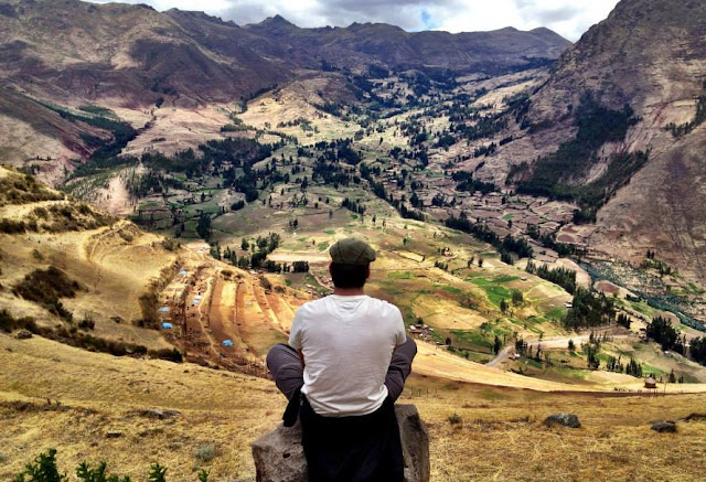 Simon sat on the Pisaq rice terraces on the Inca Trail