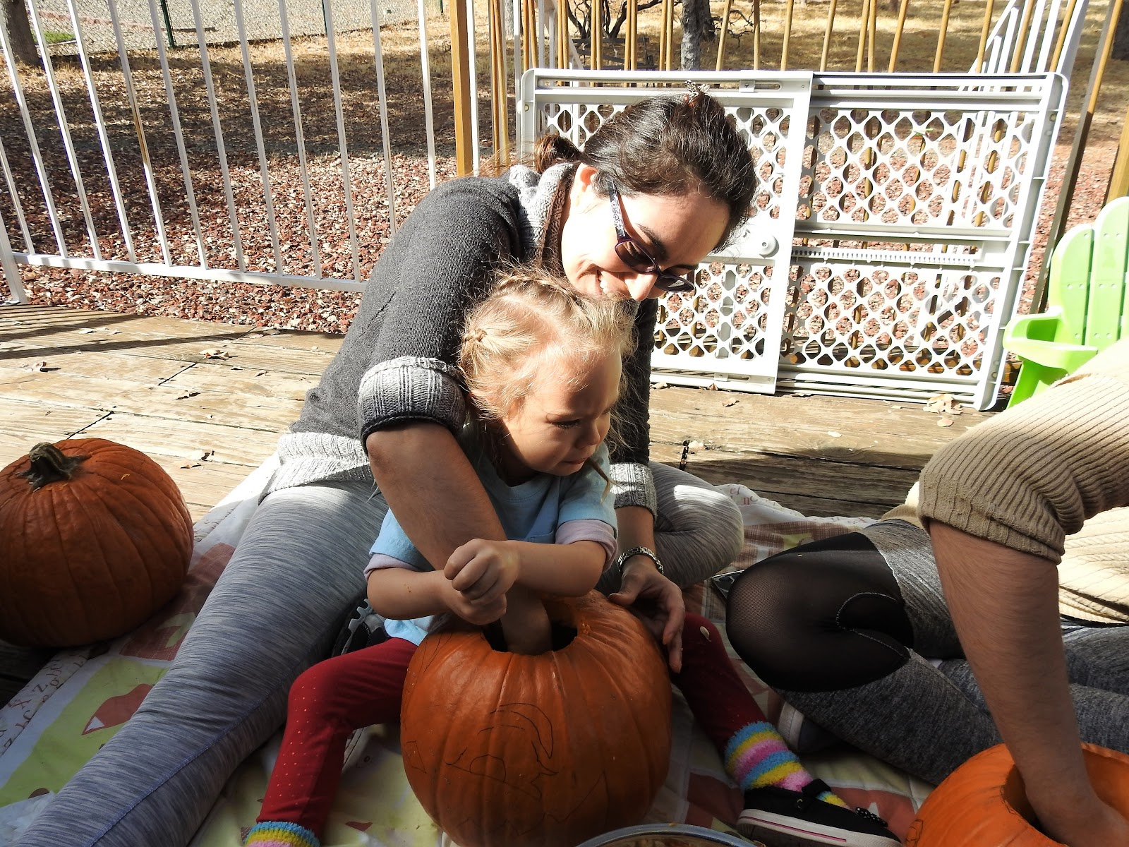 family carving pumpkin