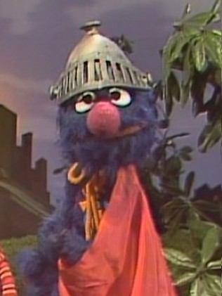 Medium close-up shot of classic Super Grover looking exasperated