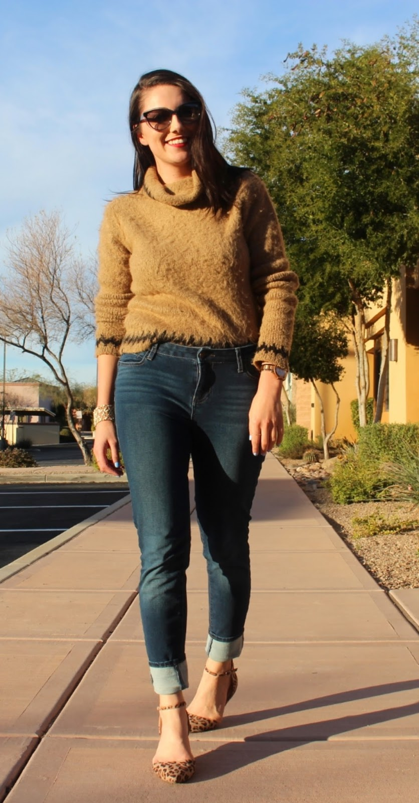 This is a full body shot of my outfit featuring a tan ASOS sweater, blue jeans and leopard flats.