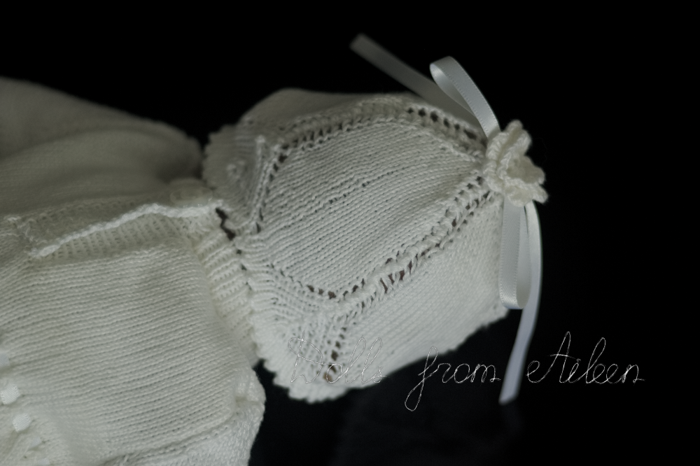 close up of back of Christening dress and hat