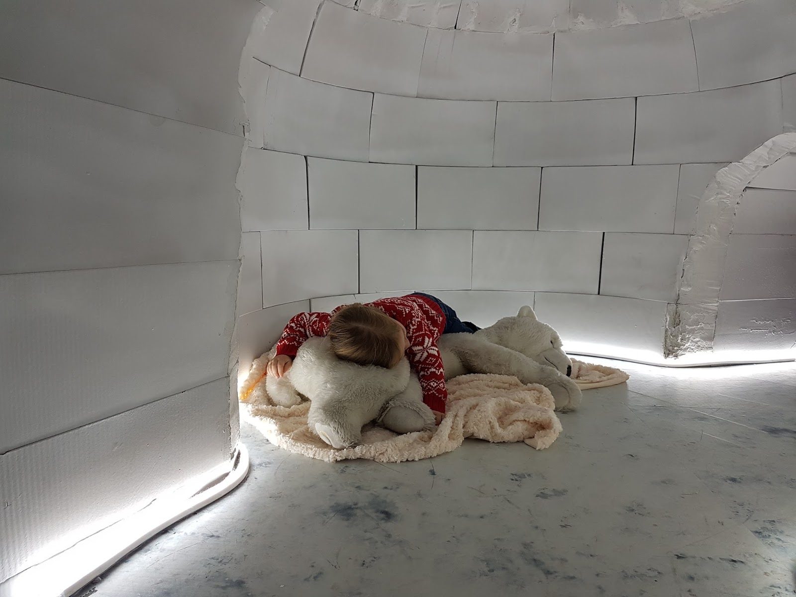 girl lying inside igloo at harrods christmas grotto 2016