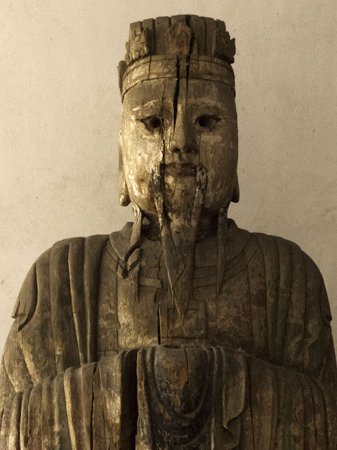 Decaying Buddha at a temple in Pingyao China