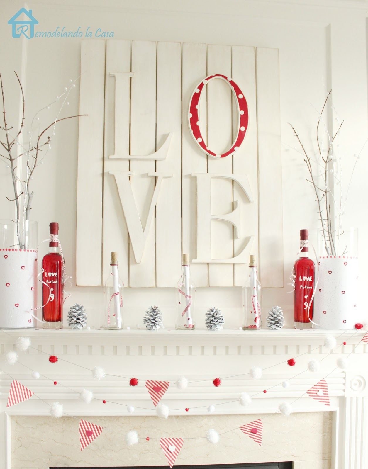 red and white valentines mantel with LOVE art and Love potion No.9