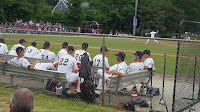 baseball players in an outdoor dugout