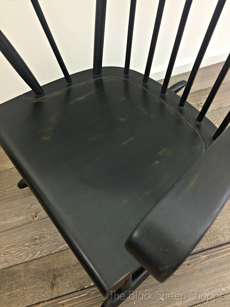 Light distressing applied to rocking chair seat
