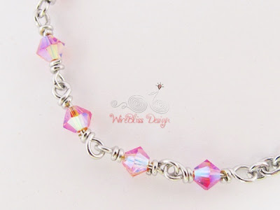 Close up of Wire wrapped minima bracelet (Minlet) with 4mm Pink Swarovski Crystals @WireBliss