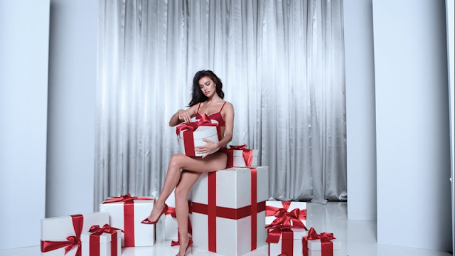 Irina Shayk smoulders for the Intimissimi Christmas Campaign 2016