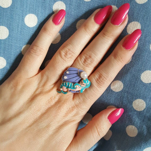mermaid shell and pearl ring on hand
