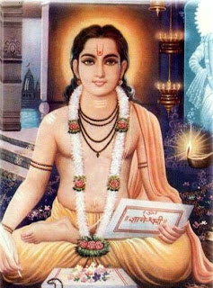 Jnaneshwar sits with a manuscript