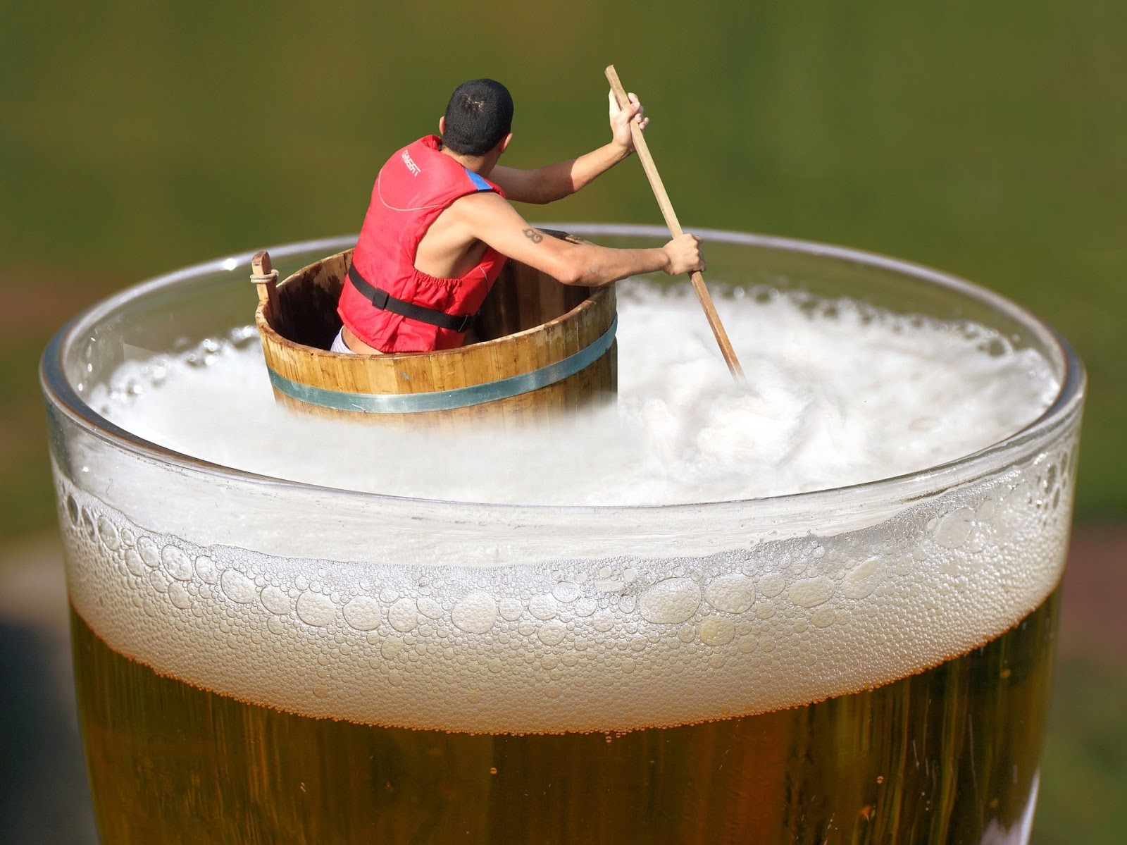 A man floating in beer.