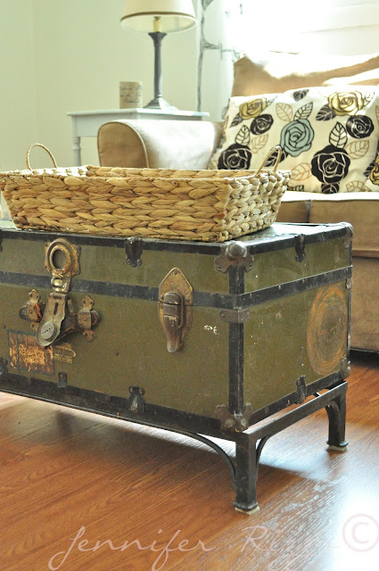 vintage trunk used as a coffee table