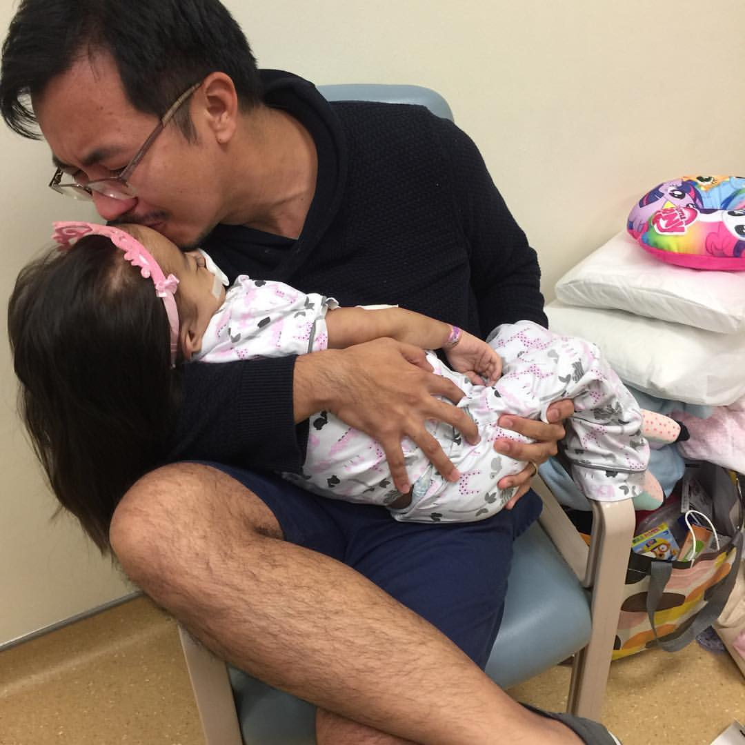 The heartbreaking photo of Courageous Caitie and her Dad.