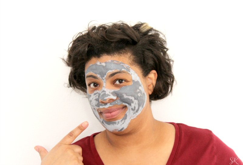 a woman with Derma E charcoal mask