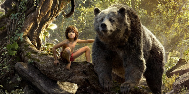 "Neel Sethi as Mowgli, alongside Bill Murray's Baloo, in ""The Jungle Book"""