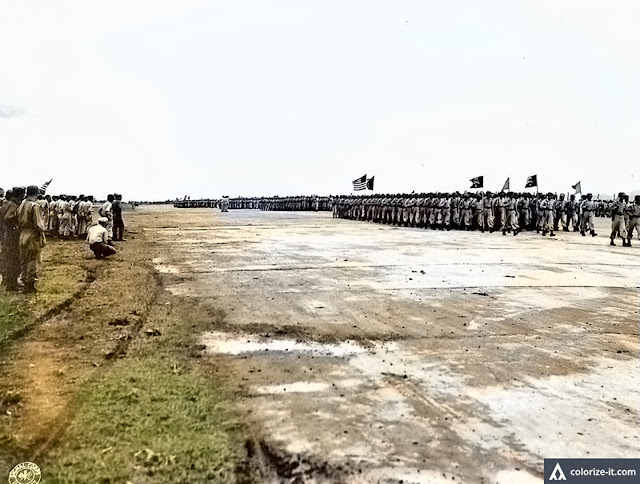 A pass in review was held in honor of Stillwell at the Lipa Airstrip.  Image source:  US National Archives.  Colorized courtesy of Algorithmia.